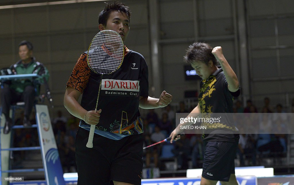 Indonesia pair Lejarsar Variella (R) and Vita Marissa celebrate a vital point against Thailand's Savitree Amitrapai and Sapsiree Taerattanachai during their women's double final of the Ayonex Australian Badminton Open 2013 in Sydney on April 7, 2013. AFP PHOTO / Saeed KHAN USE