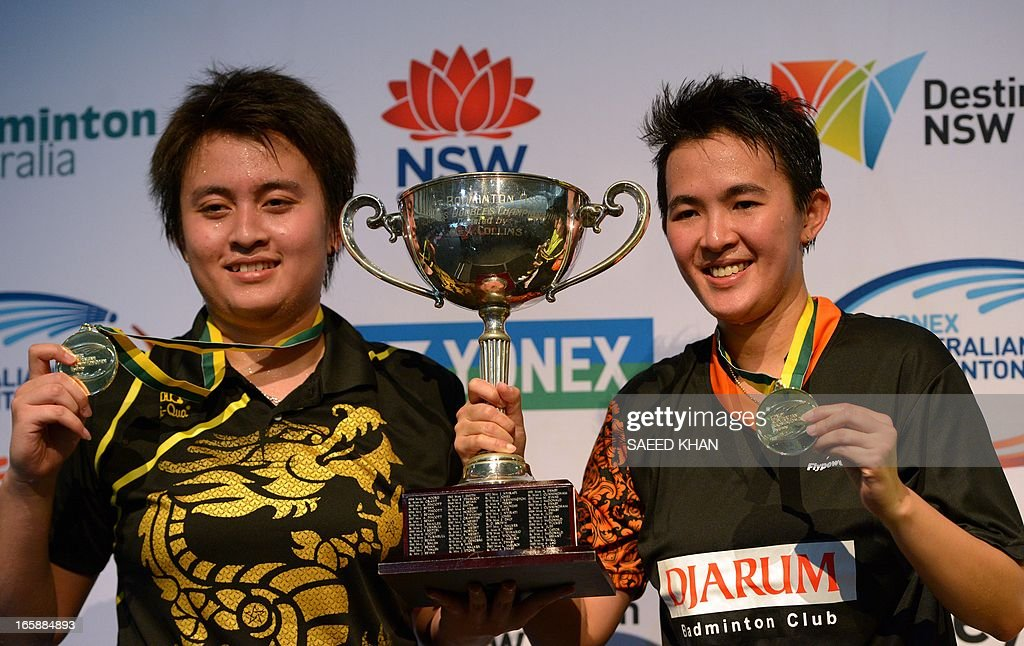 Indonesia pair Lejarsar Variella (L) and Vita Marissa display their medals and a winning trophy after defeating Thailand's Savitree Amitrapai and Sapsiree Taerattanachai in the women's double final of the Ayonex Australian Badminton Open 2013 in Sydney on April 7, 2013. AFP PHOTO / Saeed KHAN USE