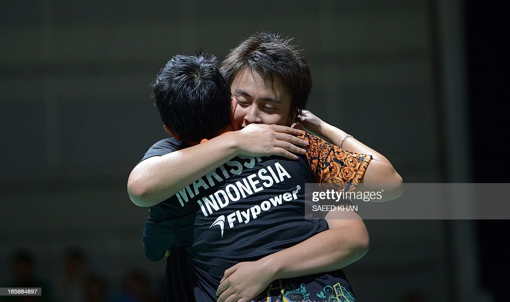 Indonesia pair Lejarsar Variella (R) hugs Vita Marissa hug after defeating Thailand's Savitree Amitrapai and Sapsiree Taerattanachai in the women's double final of the Ayonex Australian Badminton Open 2013 in Sydney on April 7, 2013. AFP PHOTO / Saeed KHAN USE