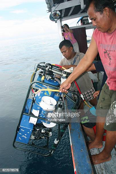 MANADO Indonesia Researchers pull an underwater camera out of the sea off Manado Indonesia on June 10 2013 An expedition team from Aquamarine...
