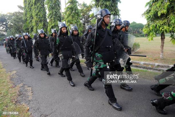 Indonesia soldiers line up during a security preparation for Indonesia presidencial election in Denpasar in Indonesia's resort island of Bali on July...