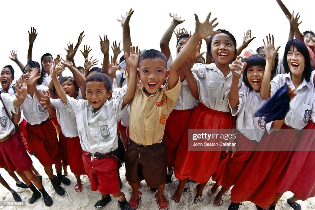 CONTENT] Indonesia, West Sumatra Province, Mentawai Islands, children in red and white Indonesia national school uniforms.