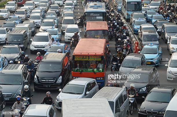 WITH IndonesiaelectioneconomyFOCUS This picture taken in Jakarta on July 3 2014 shows vehicles on a road in Jakarta The winner of this week's...