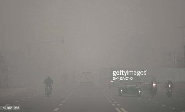 IndonesiaenvironmentpollutionFOCUS by Dessy Sagita This photo taken on October 27 2015 shows motorists driving through thick haze in Palangkaraya a...