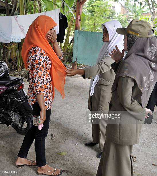 IndonesiaIslampolicerightsAcehFEATURE by Jerome Rivet This photo taken on December 2 2009 shows female Acehnese sharia police lecturing a woman who...