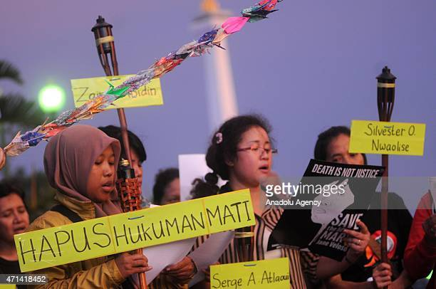 Indonesian activists hold a protest for the death row drug traffickers to stop death penalty at outside of Presidential Palace in Jakarta Indonesia...