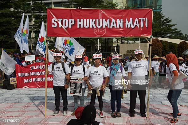 Indonesian activists protest against the death penalty in response to the execution of 2 Indonesian maids in Saudi Arabia recently during a march of...