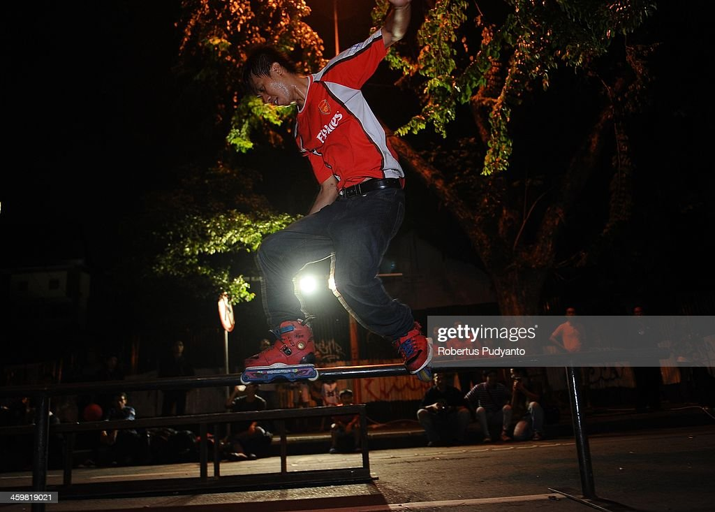 Indonesian Agresif in Line Skate members perform street acrobatic to celebrate 2014 New Years on December 31, 2013 in Surabaya, Indonesia. A wave of pyrotechnic displays kicked off New Years celebrations in major cities around the world.