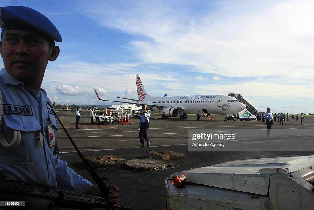 Indonesian Air Force army guard Boeing 737-800 of Virgin Australia at Ngurah Rai International Airport in Kuta, Bali on Friday, April 25, 2014. An Indonesian airport went on alert Friday as the air force announced that a plane approaching Ngurah Rai International in Bali had been hijacked in midair. Airline official Heru Sudjatmiko announced minutes later that an intoxicated passenger on the Virgin Australia flight from Brisbane had been arrested for creating a disturbance.