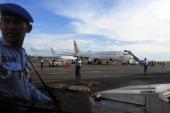 Indonesian Air Force army guard Boeing 737800 of Virgin Australia at Ngurah Rai International Airport in Kuta Bali on Friday April 25 2014 An...