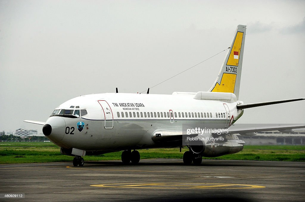 Indonesian Air Force Boeing 737 AI7302 has landed carrying two victims of the AirAsia flight QZ8501 crash at Indonesian Military Base Operation...