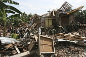Indonesian Armed Forces search for bodies in the rubble of a wrecked house in devastated Bantul district May 29 2006 near Yogyakarta Central Java...