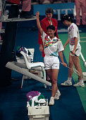 Indonesian badminton player Susi Susanti raises her arm in celebration after being awarded the gold medal in the final of the Women's singles...