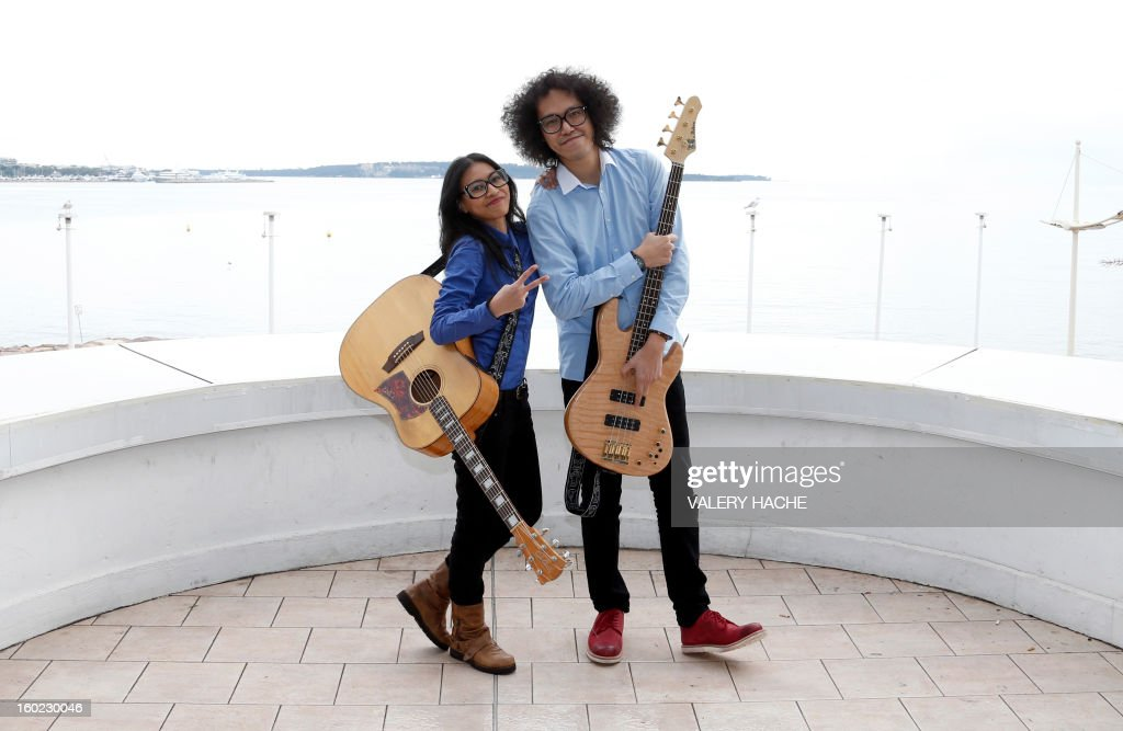 Indonesian band musicians Endah N Rhesa pose during a photocall as part of the music world's largest annual trade fair, Midem, on January 28, 2013 in Cannes, southeastern France. The Midem music trade show will bring 7,000 of the global industry's biggest players together on the French Riviera for four days. AFP PHOTO / VALERY HACHE