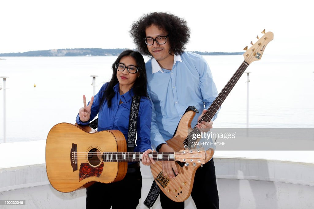 Indonesian band musicians Endah N Rhesa pose during a photocall as part of the music world's largest annual trade fair, Midem, on January 28, 2013 in Cannes, southeastern France. The Midem music trade show will bring 7,000 of the global industry's biggest players together on the French Riviera for four days.