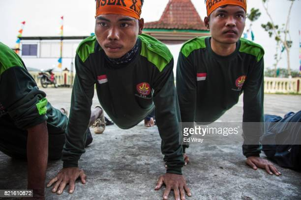 Indonesian Banser recruits do pushups as a punishment for being late to a class during a rigorous three day induction course on July 22 2017 in...