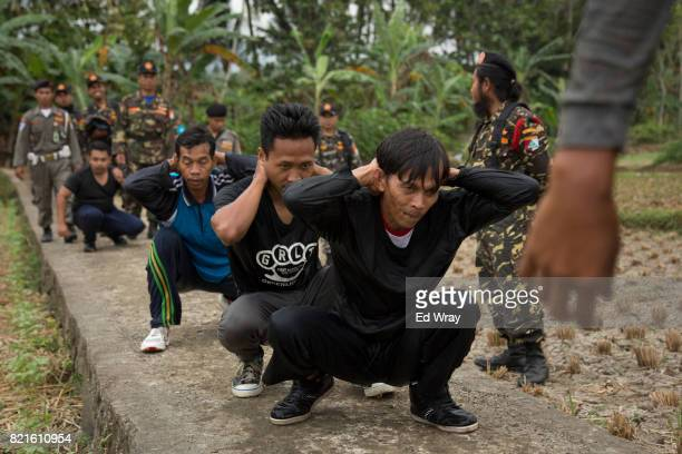Indonesian Banser recruits frog march after jumping into a river as part of a three day induction course on July 21 2017 in Kebumen Indonesia Banser...