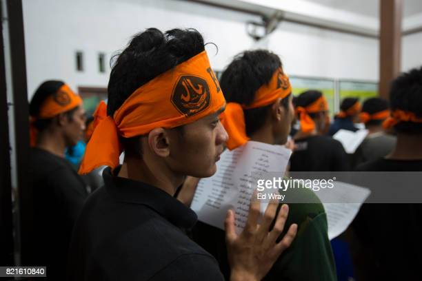 Indonesian Banser recruits listen during a class lecture about Indonesia's pluralistic philosophy called 'Pancasila' during a rigorous three day...