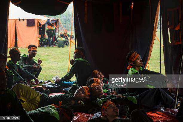 Indonesian Banser recruits relax after a training session during a rigorous three day induction course on July 22 2017 in Kebumen Indonesia Banser...