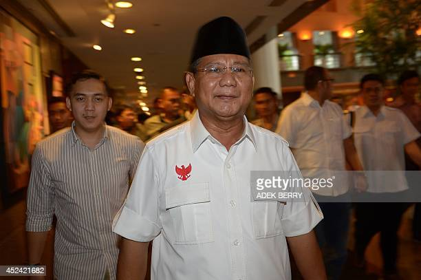 Indonesian candidate Prabowo Subianto walks with his team after a meeting in Jakarta on July 20 2014 Jakarta governor Joko Widodo is expected to be...