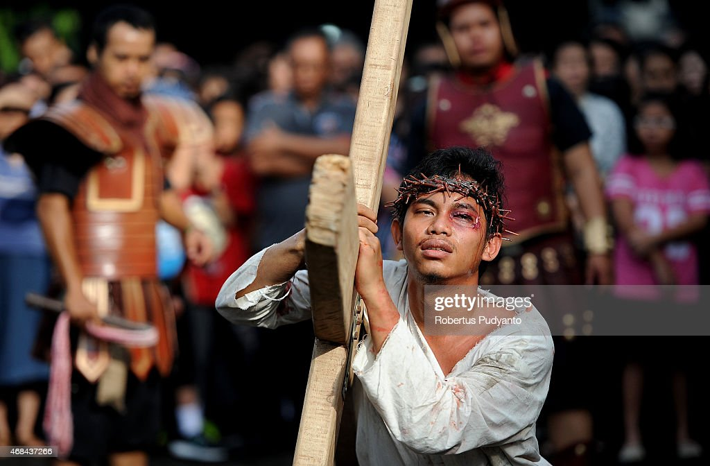 Indonesian Catholic devotees participate in a re-enactment of the crucifixion of <a gi-track='captionPersonalityLinkClicked' href=/galleries/search?phrase=Jesus+Christ&family=editorial&specificpeople=75454 ng-click='$event.stopPropagation()'>Jesus Christ</a> during a Good Friday procession at Roh Kudus Church on April 3, 2015 in Surabaya, Indonesia. Indonesian Catholics celebrate Good Friday along with millions of Roman Catholics around the world, marking the day <a gi-track='captionPersonalityLinkClicked' href=/galleries/search?phrase=Jesus+Christ&family=editorial&specificpeople=75454 ng-click='$event.stopPropagation()'>Jesus Christ</a> was crucified.
