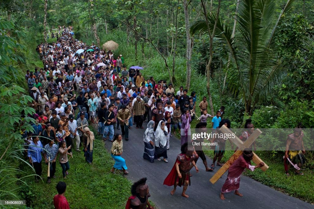 Indonesian Catholics participate in a re-enactment of the crucifixion of Jesus Christ on Good Friday on March 29, 2013 in Magelang, Central Java, Indonesia. Catholics make up approximately 3% of the population of the predominantly Muslim country.