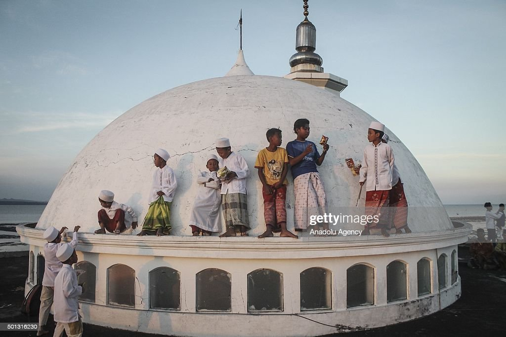 Indonesian child muslims play at the mosque dome before a Rukyatul Hilal to see the new crescent moon that determines the start of Ramadan Holy Month...