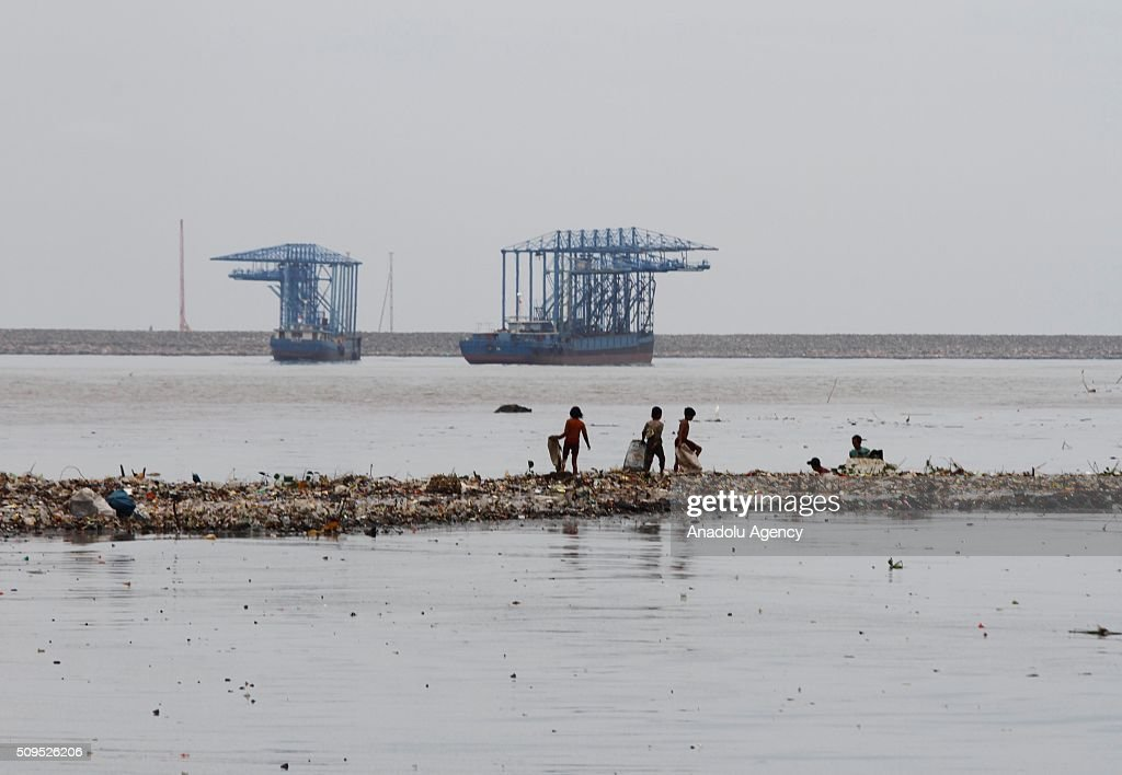 Indonesian children collect garbages on the coast near a fishing village in Jakarta, Indonesia, on February 11, 2016. According to scientists 8 million metric tones of plastic pollution enter the oceans each year from the world's 192 coastal countries based on 2010 data.