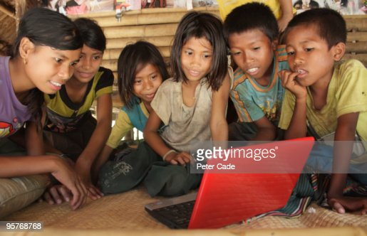 indonesian children looking at laptop