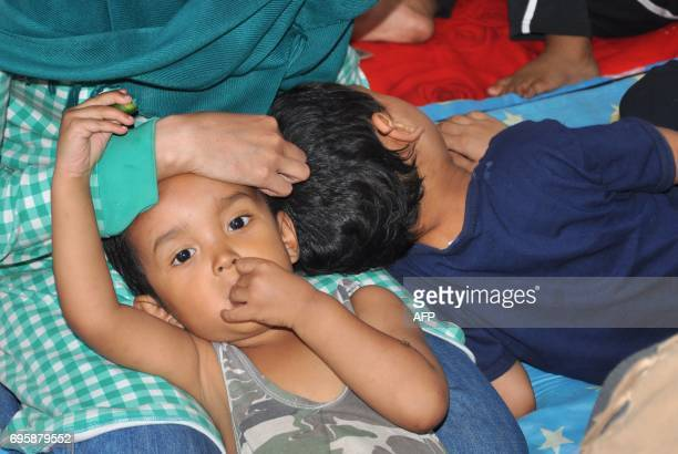 Indonesian children rest following their arrival at the Ain Issa camp 50 kilometres north of Raqa after fleeing the Islamic State group's Syrian...