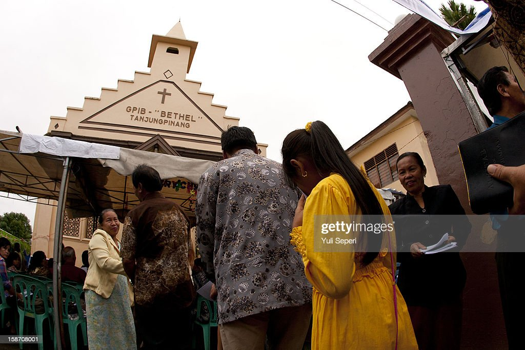 Indonesian Christians pray on Christmas day at GPIB Bethel Church or locally called 'Gereja Ayam' on December 25, 2012 in Batam Island, Indonesia. Christmas is a national holiday in Indonesia despite only eight percent of the population identifying as Christian. Muslims in Indonesia celebrate the birth of Jesus and Hindu's in the country also commemorate the date.