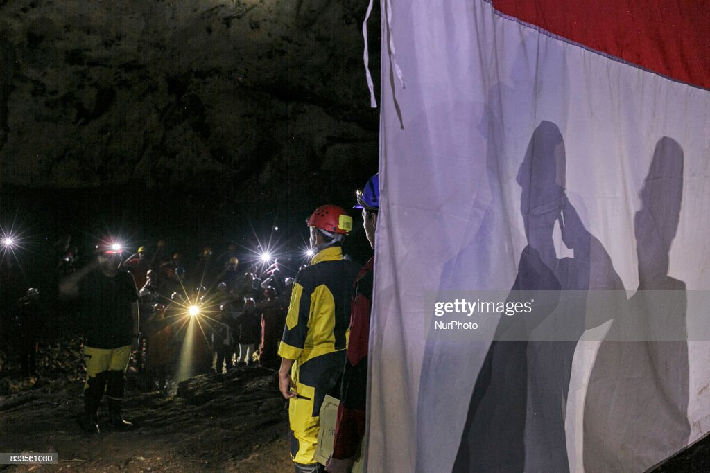 Indonesian citizens salute an Indonesian flag during a ceremony marking Indonesia's 72nd Independence Day inside the Jlamprong Cave in Yogyakarta, Indonesia on August 17, 2017.