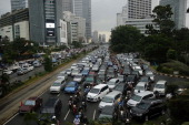 Indonesian commuters sit in traffic on December 19 2013 in Jakarta Indonesia Transportation experts have been warning that Jakarta could experience...
