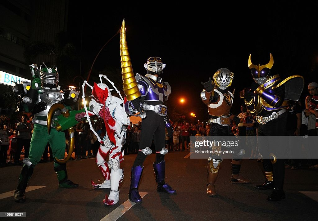 Indonesian Cosplay Community perform on the street to celebrate 2014 New Years on December 31, 2013 in Surabaya, Indonesia. A wave of pyrotechnic displays kicked off New Years celebrations in major cities around the world.
