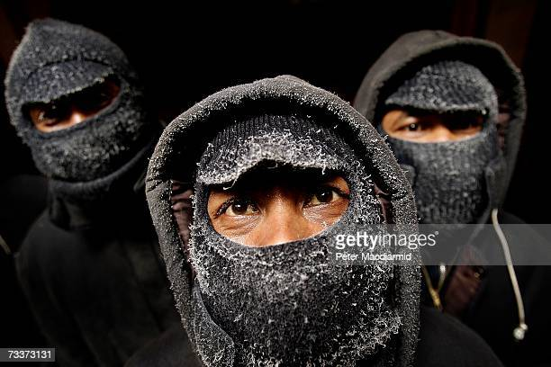 Indonesian crew members wear frost covered balaclavas as they work deep in the trawler Ferralemes' refrigerated hold on February 4 2007 in Stanley...