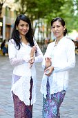 Two women posing in traditional Indonesian culture.