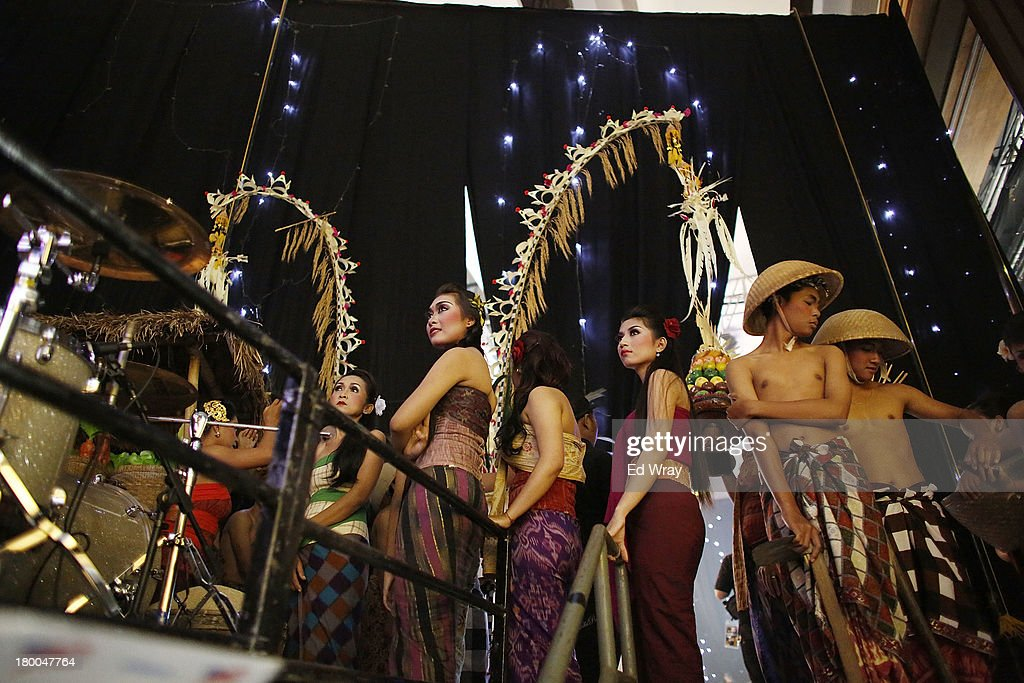 Indonesian dancers wait backstage during the Miss World 2013 Indonesia opening show on September 8, 2013 in Nusa Dua, Indonesia. Indonesia's government has moved the final round of the Miss World pageant from main Java island to the resort island of Bali due to the ongoing Muslim protests.