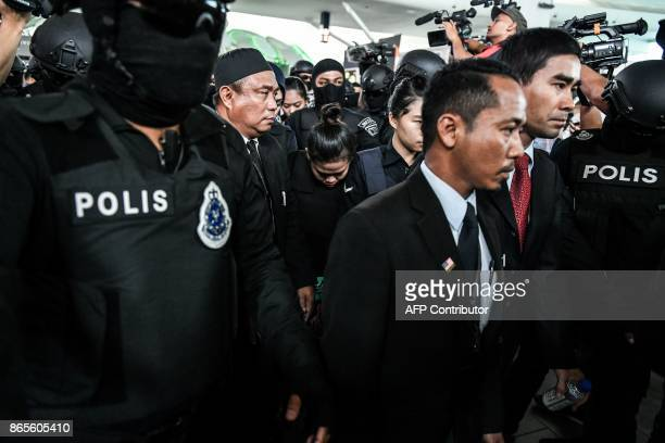 Indonesian defendant Siti Aisyah is escorted by police personnel at the lowcost carrier Kuala Lumpur International Airport 2 during a visit to the...