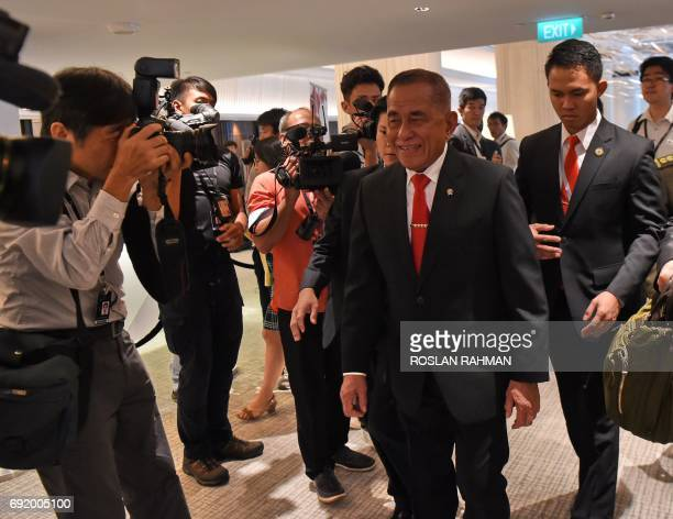 Indonesian Defense Minister General Ryamizard Ryacudu leaves the fourth plenary session during the 16th Institute for Strategic Studies ShangriLa...