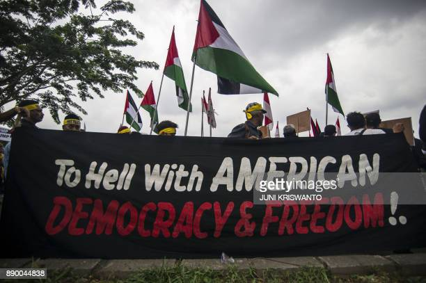 Indonesian demonstrators attend a protest against US President Donald Trump's recognition of Jerusalem as the capital of Israel outside the US...