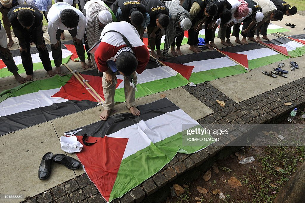 Indonesian demonstrators hold their afternoon prayer over Palestinian flags during a break from their protest outside the US embassy in Jakarta on June 2, 2010, denouncing the Israel assault on an aid flotilla bound for Gaza. World leaders demanded Israel to release detainees taken of six ships that were raided by Israel commandos in a botched operation in which nine passengers were killed, amid mounting international pressure for a full investigation of the fiasco.