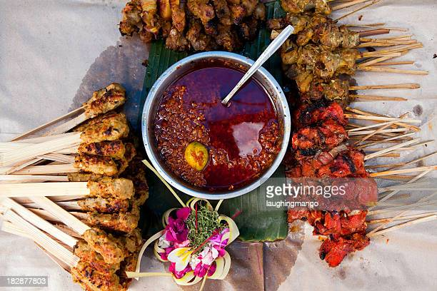 Indonesian dish with satay chicken skewers