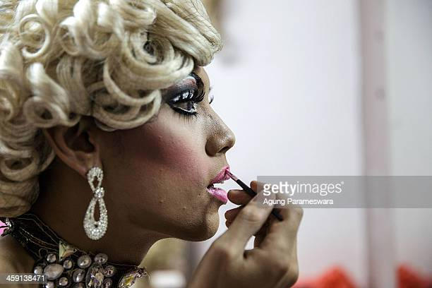 Indonesian drag queen Tracy puts applies lipstick to prepare for a special performance on the 5th anniversary celebrations of Bali Joe Bar one of the...
