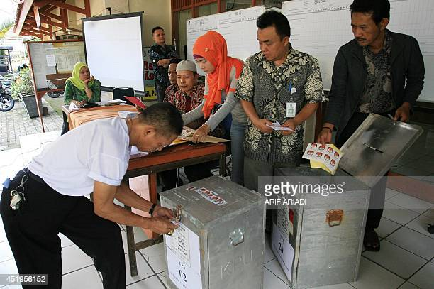 Indonesian electoral officials check ballot boxes at a local election center a day after Indonesia's presidential elections in Jakarta on July 10...