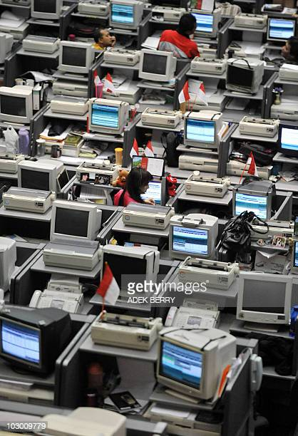 Indonesian employees of Bursa Efek Indonesia or Indonesia's Stock Exchange work during a trading in Jakarta on January 23 2009 Indonesian shares are...