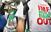 Indonesian farmers and their supporters shout antiIMF and World Bank slogans during a demonstration in front of the parliament in Jakarta 19...