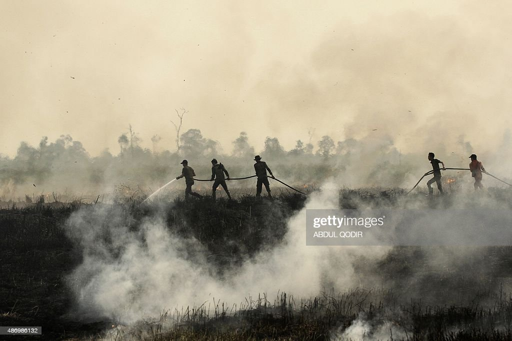Indonesian fire fighters put out a fire in Ogan Ilir South Sumatra on September 5 2015 Haze across much of Southeast Asia mostly comes from forest...