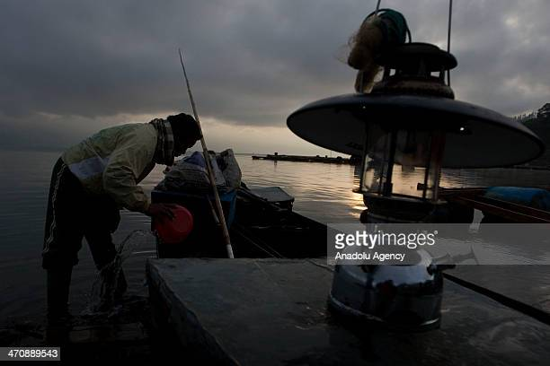 Indonesian fishermen catch fish on the located in Lake Laut Tawar Central Aceh Indonesia on February 21 2014 It is the largest lake in Aceh with an...