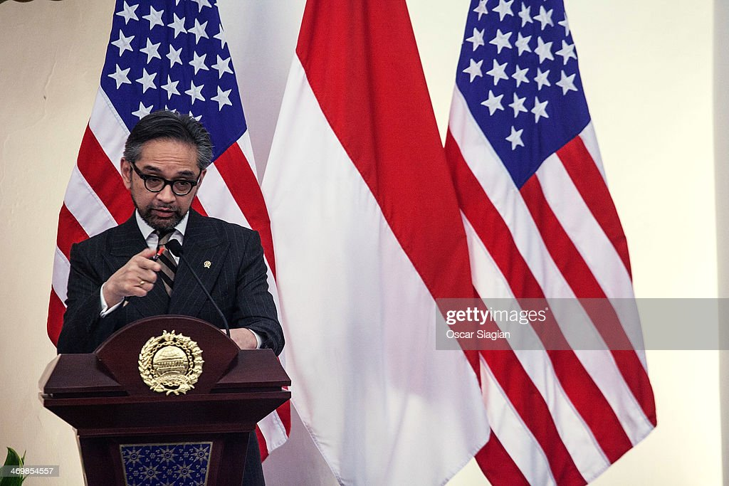 Indonesian Foreign Minister <a gi-track='captionPersonalityLinkClicked' href=/galleries/search?phrase=Marty+Natalegawa&family=editorial&specificpeople=2862416 ng-click='$event.stopPropagation()'>Marty Natalegawa</a> answers questions from the media during a joint press conference with U.S. Secretary of State John Kerry on February 17, 2014 in Jakarta, Indonesia. Kerry arrived in Indonesia on a visit to highlight concerns over climate change, after agreeing with China to boost joint efforts to fight global warming