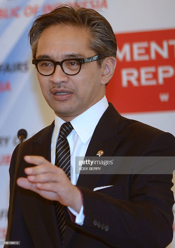 Indonesian Foreign Minister Marty Natalegawa gestures during a press conference at the Foreign Ministry office in Jakarta on May 6, 2013. Indonesia on May 6 summoned the British ambassador in Jakarta to protest after a group supporting the independence of the restive Papua region set up its headquarters in England, the envoy said.